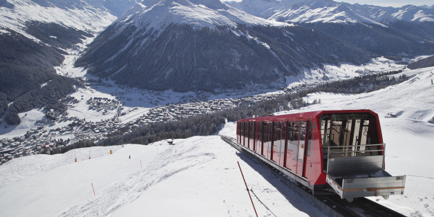 A cable train makes its way up the Weissfluhjoch mountain  in Davos, Switzerland, Monday, Jan. 19, 2015. The world's financial and political elite will head this week to the Swiss Alps for 2015's gathering of the World Economic Forum , WEF, at the Swiss ski resort of Davos. (AP Photo/Michel Euler)