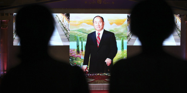 Unification Church believers attend the memorial ceremony for the first death anniversary of the late Rev. Sun Myung Moon, the founder of the Unification Church, at the CheongShim Peace World Center in Gapyeong, South Korea, Friday, Sept. 23, 2013. (AP Photo/Ahn Young-joon)