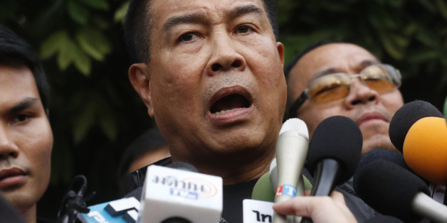 Thai police chief Somyot Pumpunmuang talks to reporters outside of an apartment on the outskirts of Bangkok, Thailand on Saturday, Aug. 29, 2015. Thai authorities raided an apartment in suburban Bangkok and arrested a foreigner Saturday with a fake Turkish passport and bomb-making materials, the first possible breakthrough in the deadly bombing at a Bangkok shrine nearly two weeks ago.(AP Photo/Sakchi Lalit)