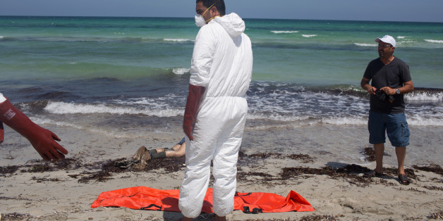 Workers for the Red Crescent pull dead migrants from the water and place them in orange-and-black body bags laid out on the waterfront in Zuwara, about 105 kilometers (65 miles) west of Tripoli, Libya, Friday, Aug. 28, 2015. Two ships went down Thursday off the western Libyan city, where Hussein Asheini of the Red Crescent said over 100 bodies had been recovered. About 100 people were rescued, according to the Office of the U.N. High Commissioner for Refugees, with at least 100 more believed to