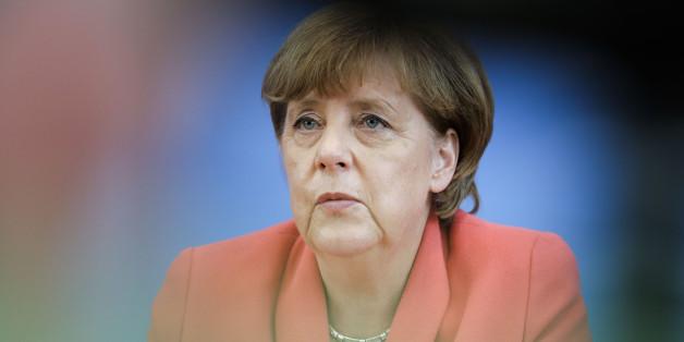 German Chancellor Angela Merkel attends her annual summer news conference in Berlin, Monday, Aug. 31, 2015. (AP Photo/Gero Breloer)