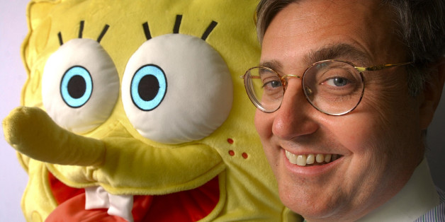 """** RETRANSMISSION TO CORRECT JEFF DUNN""""S TITLE TO  PRESIDENT OF NICKELODEON ENTERPRISES, NOT PRESIDENT OF NICKELODEON ** Jeff Dunn, president of Nickelodeon Enterprises, stands with Sponge Bob Square Pants Friday, Jan. 31, 2003 in New York.  Nickelodeon has won the hearts of children and the wallets of their parents by parlaying the success of it's TV hits like """"Spongebob SquarePants""""  into a slew of hot products. (AP Photo/ Teru Iwasaki)"""