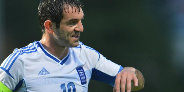 Greece's Georgios Karagkounis reacts during a friendly soccer match between Greece and  Armenia  in Kufstein, Austria, Thursday, May 31, 2012. (AP Photo/ Kerstin Joensson)