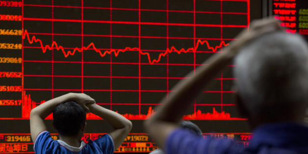 Investors monitor a display showing the Shanghai Composite Index at a brokerage in Beijing, Monday, Aug. 31, 2015. Asian stocks fell Monday after a U.S. Federal Reserve official suggested a September interest rate hike still was possible and Japanese factory activity weakened. (AP Photo/Ng Han Guan)