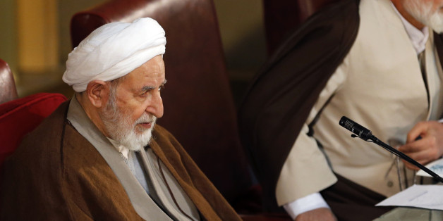 Newly elected chairman of the Iran's Assembly of Experts Ayatollah Mohammad Yazdi sits in a biannual meeting of the assembly in Tehran, Iran, Tuesday, March 10, 2015. Iran's most influential clerical body charged with choosing or dismissing the nation's supreme leader has elected a hard-line ayatollah as its new chairman, the official IRNA news agency reported on Tuesday. IRNA said Mohammad Yazdi, the deputy chairman of the 86-member Assembly of Experts, got 47 votes in his favor from among 73 c