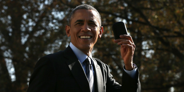 WASHINGTON, DC - NOVEMBER 21:  U.S. President Barack Obama holds up his Blackberry after he ran back into the White House after forgetting the mobile phone while departing for a domestic trip November 21, 2014 in Washington, DC. Obama is scheduled to travel to Las Vegas later today to speak about immigration reform. (Photo by Win McNamee/Getty Images)