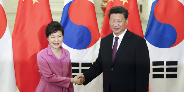 Chinese President Xi Jinping, right, shakes hands with South Korean President Park Geun-hye at the Great Hall of the People in Beijing, Wednesday, Sept. 2, 2015. World leaders are in Beijing to attend events related to China's commemoration of the 70th anniversary of the end of World War II. (Lintao Zhang/Pool Photo via AP)