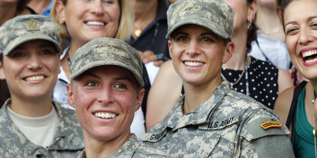 U.S. Army First Lt. Shaye Haver, center, and Capt. Kristen Griest, right, pose for photos with other female West Point alumni after an Army Ranger school graduation ceremony, Friday, Aug. 21, 2015, at Fort Benning, Ga. Haver and Griest became the first female graduates of the Army's rigorous Ranger School, putting a spotlight on the debate over women in combat.   (AP Photo/John Bazemore)