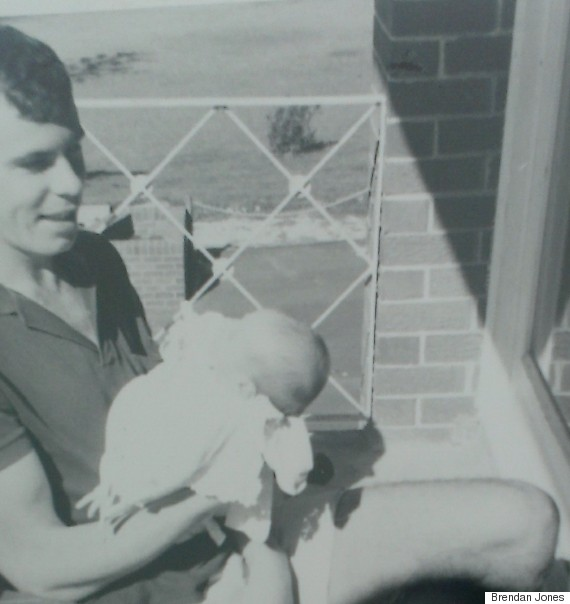 baby brendan being held by his dad