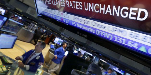 A television screen on the floor of the New York Stock Exchange shows the decision of the Federal Reserve, Wednesday, July 29, 2015. The Federal Reserve appears on track to raise interest rates later this year but is signaling that it wants to see further economic gains and higher inflation before doing so. (AP Photo/Richard Drew)