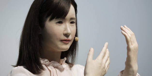 Communication android 'Aiko Chihira', developed by Toshiba Corp., performs sign language during a demonstration at the Cutting-Edge IT & Electronics Comprehensive Exhibition (CEATEC) in Chiba, Japan, on Tuesday, Oct. 7, 2014. CEATEC will run until Oct. 11. Photographer: Kiyoshi Ota/Bloomberg via Getty Images