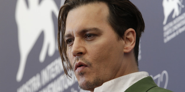 Actor Johnny Deep poses during the photo call for the movie Black Mass at the 72nd edition of the Venice Film Festival in Venice, Italy, Friday, Sept. 4, 2015. (AP Photo/Andrew Medichini)