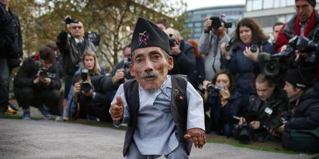 LONDON, ENGLAND - NOVEMBER 13:  The shortest man ever, Chandra Bahadur Dangi meets the worlds tallest man, Sultan Kosen (not in shot) for the very first time on November 13, 2014 in London, England. Chandra from Nepal measuring 54.6 cm (21.5 inches) posed for photographers with Sultan from Turkey who is 251 cm (8 ft 3 inches). Today is the 10th annual Guinness World Records Day during which thousands of people are expected to come together to celebrate the international day of record-breaking!  (Photo by Peter Macdiarmid/Getty Images)