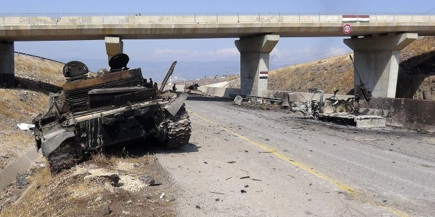 IDLIB, SYRIA - JULY 29: A destroyed tank of Assad forces is seen after Syrian oppositions linked to Fatah forces capture Aleppo, Idlib, Latakia highway, 13 military area and two village, in Idlib, Syria, on July 29, 2015. (Photo by Ibrahim Hatibi/Anadolu Agency/Getty Images)