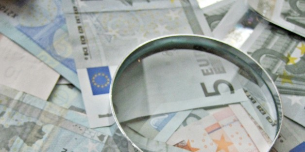 """A pile of Euro notes and magnifying glass. This image would be great if you were writing an article about analyzing your finances or savings.   Like much of our work, we have put all these images in the public domain. Feel free to use them but please credit out site as the source if you do: <a href=""""http://TaxRebate.org.uk"""" rel=""""nofollow"""">TaxRebate.org.uk</a>"""