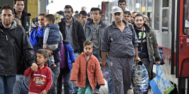 Refugees from Syria arrive at the train station  in Dortmund, Germany, Sunday, Sept. 6, 2015. Thousands of migrants and refugees arrived in Dortmund by trains. (AP Photo/Martin Meissner)