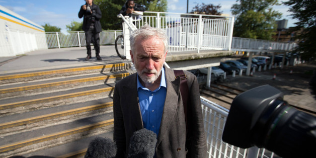 STEVENAGE, ENGLAND - AUGUST 25:  Labour leadership candidate Jeremy Corbyn (L) speaks to the media as he leaves a radio hustings on August 25, 2015 in Stevenage, England. Candidates are continuing to campaign for Labour party leadership with polls placing left-winger Jeremy Corbyn in the lead with the results due to be announced on September 12.  (Photo by Carl Court/Getty Images)