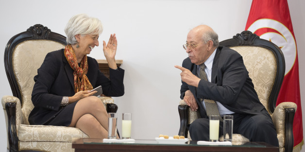 TUNIS, TUNISA - SEPTEMBER 7: In this handout photo provided by the IMF, International Monetary Fund Managing Director Christine Lagarde meets with Central Bank of Tunisia, Chedly Ayari (R) at the Carthage Airport on  September 7, 2015 in Tunis, Tunisia.  (Photo by Stephen Jaffe/IMF via Getty Images)