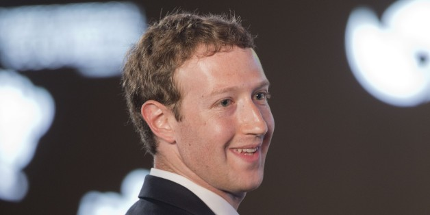 Facebook CEO Mark Zuckerberg asks a question during the CEO Summit of the Americas panel discussion in Panama City, Panama, Friday, April 10, 2015. (AP Photo/Pablo Martinez Monsivais)