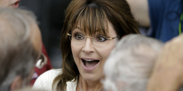 Former Alaska Gov. Sarah Palin greets supporters after speaking to Tea Party members during the Restoring America event, Saturday, Sept. 3, 2011, in Indianola, Iowa. (AP Photo/Charlie Neibergall)