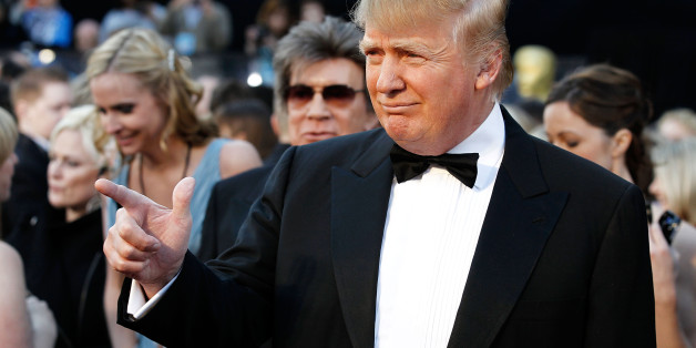 Donald Trump arrives before the 83rd Academy Awards on Sunday, Feb. 27, 2011, in the Hollywood section of Los Angeles. (AP Photo/Matt Sayles)