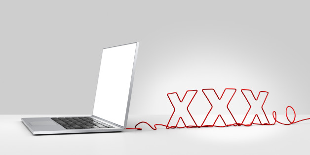 Laptop computer with a red ethernet cable forming 'XXX', coming out of the back on a plain background
