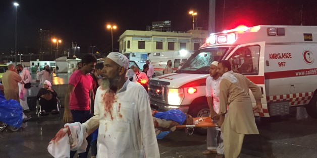 MECCA, SAUDI ARABIA - SEPTEMBER 11: Paramedics and officals hospitalize wounded people after a construction crane collapsed over the Muslim pilgrims around the Muslims' holy place Kaaba in Mecca, Saudi Arabia on September 11, 2015. Crane crash, believed collapsed by strong winds, killed at least 52 people and left many others wounded. Kaaba and surrounded area were under construction due to expansion reasons. (Photo by Ozkan Bilgin/Anadolu Agency/Getty Images)