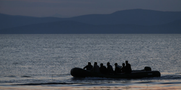 A dinghy with Syrian migrants is towed by a Greek coast guard patrol boat into the port of Kos, Greece, following a rescue operation in a part of the Aegean Sea between Turkey and Greece Sunday, May 31, 2015. Greece and Italy are the main points of entry into the European Union for refugees and economic migrants from the Middle East and Africa hoping to reach other European Union countries. (AP Photo/Petros Giannakouris)