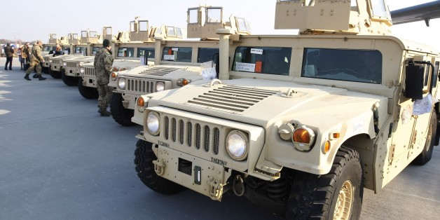 "The latest in unarmored Humvees--nicknamed the ""Pope mobile"" because of the windowed turret"