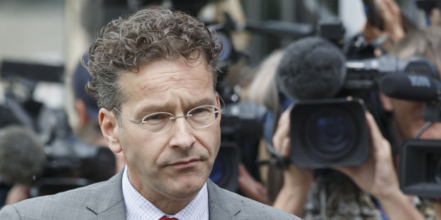 Dutch Finance Minister and chair of the eurogroup Jeroen Dijsselbloem, walks past the media after a meeting of eurozone finance ministers at the EU LEX building in Brussels on Tuesday, July 7, 2015. Greek Prime Minister Alexis Tsipras was heading Tuesday to Brussels for an emergency meeting of eurozone leaders, where he will try to use a resounding referendum victory to eke out concessions from European creditors over a bailout for the crisis-ridden country. (AP Photo/Michel Euler)