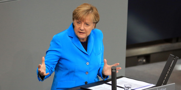 Angela Merkel, Germany's chancellor, gestures as she addresses the lower-house of the Bundestag in Berlin, Germany, on Wednesday, Sept. 9, 2015. The Chancellor said her government's fiscal security will allow it to react to 'newly emerging risks' as faltering markets abroad cause instability in the global economy. Photographer: Krisztian Bocsi/Bloomberg via Getty Images