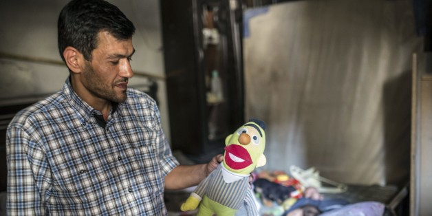 Abdullah Kurdi, father of three-year-old Aylan Kurdi (also know as Aylan Shenu) who drowned off Turkey, Abdullah Kurdi stands in Aylan's room on September 6, 2015 in Kobane. Aylan Kurdi was buried with his four-year-old brother and mother on September 4 in Kobane. They had been living in Damascus but were forced to flee the war's instability which has left more than 240,000 people dead, more than four million have sought refuge in nearby countries, and millions more have been internally displace