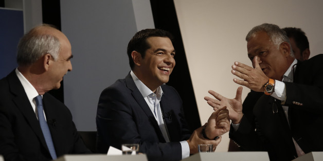 Alexis Tsipras, former Greek prime minister, center, and Evangelos Meimarakis, leader of the New Democracy Party of Greece, left, speak with ERT managing director Lampis Tagmatarhis prior a television debate at the studios of Greek state broadcaster ERT, also known as the Hellenic Broadcasting Organisation, in Athens, Greece, on Wednesday, Sept. 9, 2015. An opinion poll over the weekend showed that no party is projected to gain enough votes for an outright parliamentary majority, signaling coali