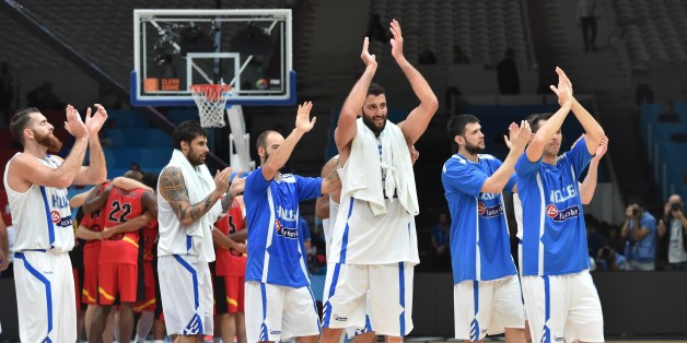(From L) Greece's power forward Kostas Kaimakoglou, Greece's power forward Georgios Printezis, Greece's shooting guard Vassilis Spanoulis and Greece's center Yannis Bourousis react after Greece defeated Belgium in their round of 16 basketball match at the EuroBasket 2015 in Lille, northern France, on September 12, 2015.  AFP PHOTO / PHILIPPE HUGUEN        (Photo credit should read PHILIPPE HUGUEN/AFP/Getty Images)