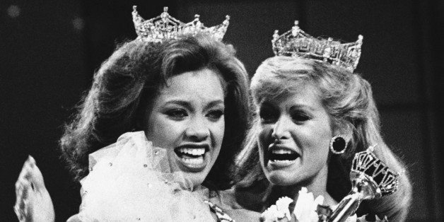 Vanessa Williams, the new Miss America, left, is shown as she is crowned, Saturday, Sept. 17, 1983 in Atlantic City, New Jersey, by the outgoing Miss America, Debra Maffett. (AP Photo)