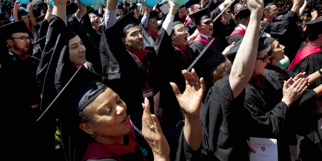 ill tGraduates of Harvard School of Government, including Susan Reed-Allen, of El Dorado, Ark., below left, wave inflatable globes as their school's degrees are conferred during Harvard University commencement exercises, in Cambridge, Mass., Thursday, May 24, 2012. (AP Photo/Steven Senne)