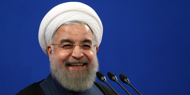 FILE - In this Aug. 29, 2015 file photo, Iran's President Hassan Rouhani smiles during his press conference in Tehran, Iran. Rouhani said Tuesday, Sept. 8, 2015 that his country is ready to hold talks with the United States and Saudi Arabia on ways to resolve the Syrian civil war, providing such negotiations can secure peace and democracy in conflict-torn Syria. Rouhani's remarks came during a press conference on Tuesday with visiting Austrian counterpart Heinz Fischer. (AP Photo/Ebrahim Noroozi