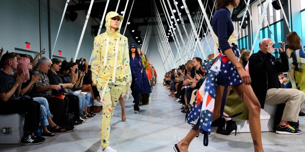 Models present designs by Lacoste during New York Fashion Week in New York on September 12, 2015. AFP PHOTO/TREVOR COLLENS        (Photo credit should read TREVOR COLLENS/AFP/Getty Images)