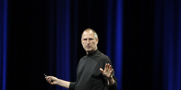"Steve Jobs, preparing to say ""boom,"" starts the show by recapping some MacOS X successes."