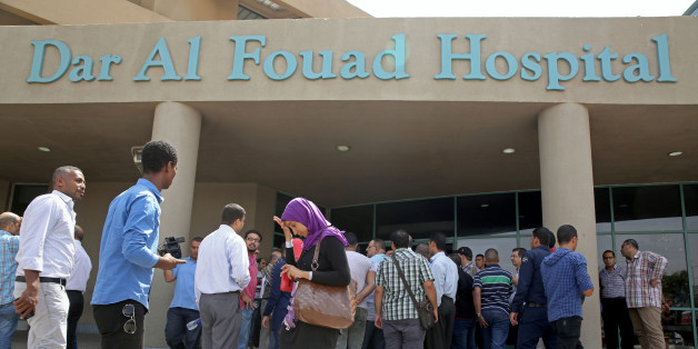 Egyptian journalists wait for information about tourists who were injured Sunday while on a desert safari trip, in front of the Dar Al Fouad Hospital in Cairo, Egypt, Monday, Sept. 14, 2015. At least 12 people were killed and 10 injured in Egypt's southwestern desert Sunday, Sept 13, 2015, when security forces mistakenly fired on a group of Mexican tourists, Egyptian officials said. The Mexican Foreign Ministry confirmed the incident and said at least two of the dead were Mexican nationals. (AP