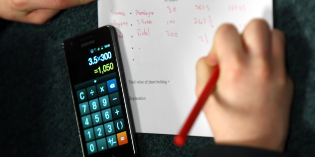 A generic stock picture of a pupil in an economics class using their mobile phone calculator to check their 'share dealings' at the Lawrence Sheriff School. Rugby today.