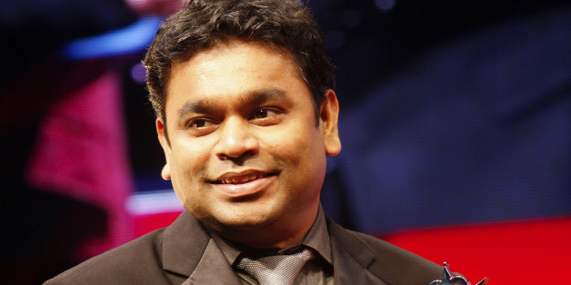 Indian artist AR Rahman smiles as he receives the award for Outstanding Achievement inn Music at The Asian Awards at Grosvenor House Hotel, Park Lane, London, on Tuesday, Oct. 26, 2010. (AP Photo/Paul Jeffers)