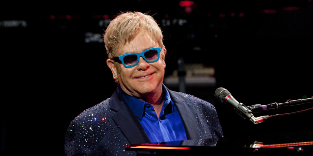 Sir Elton John and his band, during his performance at Royal Theatre in Madrid, Spain. Monday, July 20, 2015. (AP Photo/Abraham Caro Marin)