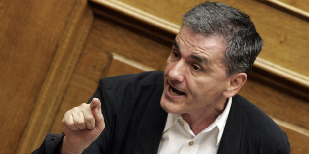 ATHENS, GREECE - JULY 22: Greek Finance Minister Euclid Tsakalotos addresses lawmakers during a parliamentary session on July 22, 2015 in Athens, Greece. Greece's leftist government tried on Wednesday to contain a rebellion in Prime Minister Alexis Tsipras' Syriza party ahead of a vote in the evening on reforms required to start talks on a rescue deal. (Photo by Milos Bicanski/Getty Images)
