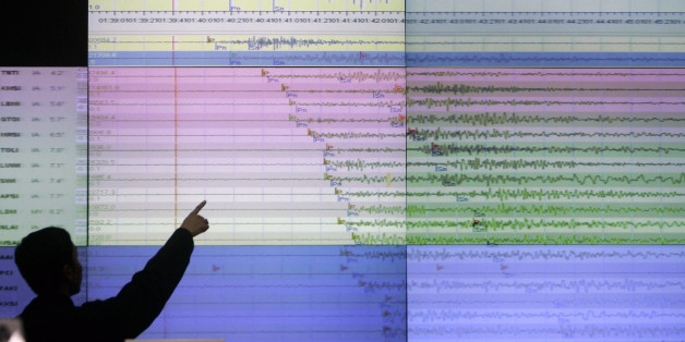 A geologist looks at a screen showing the seismograph reading of the powerful earthquake that rocked Sumatra island at the office of Indonesia's meteorological agency in Jakarta, Indonesia, Wednesday, Sept. 30, 2009. The U.S. Geological Survey said the quake had a preliminary magnitude of 7.9, and struck 30 miles (50 kilometers) off the coast of Sumatra. (AP Photo/Irwin Fedriansyah)