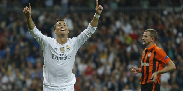 Real Madrid's Cristiano Ronaldo celebrates scoring his side's 3rd goal during a Group A Champions League soccer match between Real Madrid and Shakhtar Donetsk at the Santiago Bernabeu stadium in Madrid, Spain, Tuesday, Sept. 15, 2015. (AP Photo/Francisco Seco)