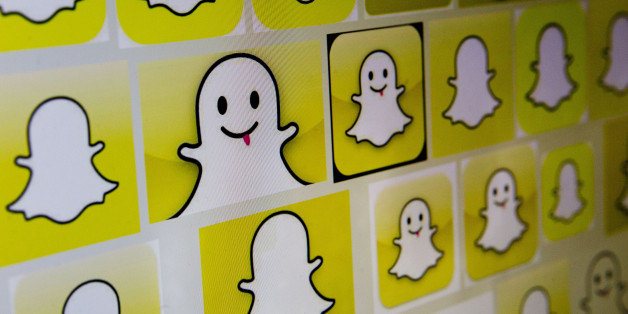 Snapchat Inc. logos are displayed on a laptop computer in Washington, D.C., U.S., on Wednesday, Feb. 18, 2015. Snapchat Inc. is raising money that could value the company at as much as $19 billion. Photographer: Andrew Harrer/Bloomberg via Getty Images