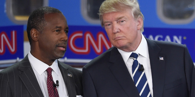 Republican presidential candidates Ben Carson, left, and Donald Trump talk before the start of the CNN Republican presidential debate at the Ronald Reagan Presidential Library and Museum on Wednesday, Sept. 16, 2015, in Simi Valley, Calif. (AP Photo/Mark J. Terrill)