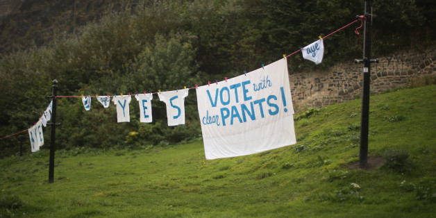 Underwear and laundry hang from a washing line below Edinburgh Castle supporting a Yes vote during the Scottish referendum campaign