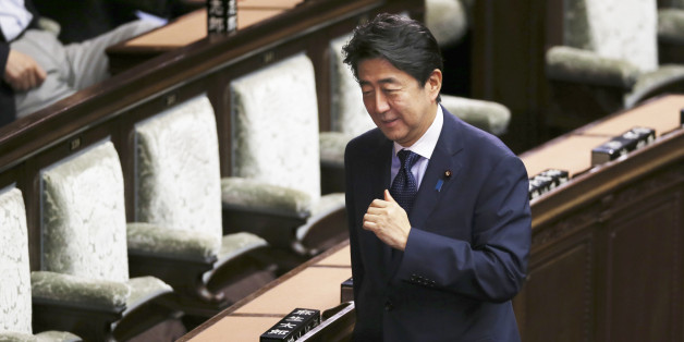 Japanese Prime Minister Shinzo Abe smiles during a vote of opposition-submitted no-confidence motion against his cabinet at the lower house of the parliament in Tokyo, Friday, Sept. 18, 2015. Opposition parties, in a last-ditch show of resistance, were delaying a vote on security bills by introducing a series of no-confidence measures against government ministers and parliamentary leaders on Friday. Japan's parliament is moving toward final approval of legislation that would loosen post-World Wa
